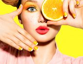 Beauty Model Girl takes Juicy Oranges. Beautiful Joyful teen girl with freckles, funny red hairstyle, yellow makeup and nails. Professional make up. Orange Slices.   t-shirt