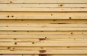 picture of 2x4  - Stacked 2 x 4 wooden studs drying or for a delivery - JPG