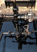 foto of oil derrick  - old pumpjack pumping crude oil from oil well - JPG