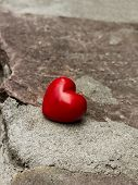 pic of lost love  - lonely red heart on a road symbol of loneliness lost love - JPG