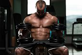 picture of pectorals  - Portrait Of A Physically Fit Young Man In A Healthy Club - JPG