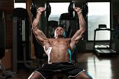 foto of pectorals  - Handsome Young Man Doing Dumbbell Incline Bench Press Workout In Gym - JPG
