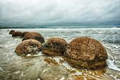 Moeraki Boulders on the Koekohe beach, Eastern coast of New Zealand. HDR image