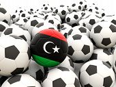 stock photo of libya  - Football with flag of libya in front of regular balls - JPG