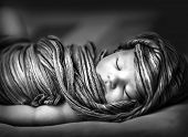 stock photo of little girls photo-models  - Closeup portrait of adorable newborn girl sleeping at home - JPG
