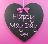 stock photo of handwriting  - Happy May Day handwriting greeting on heart shaped blackboard for 1st First of May celebrations on pink background - JPG