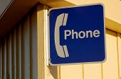 stock photo of hookup  - Phone sign on a pier in Monterey - JPG