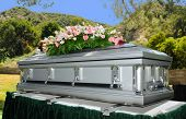 stock photo of mortuary  - Image of a stainless steel Casket with Flowers - JPG