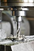 pic of auger  - Close up machining tool drill during metal cutting process boring a hole - JPG