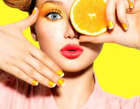image of freckle face  - Beauty Model Girl takes Juicy Oranges - JPG