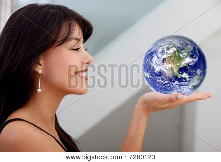Business Woman Holding Earth