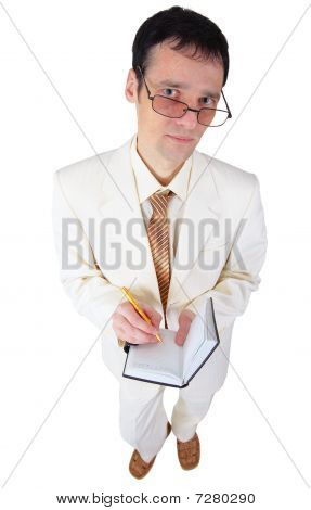 Young Man In White Suit With Notebook In Hands
