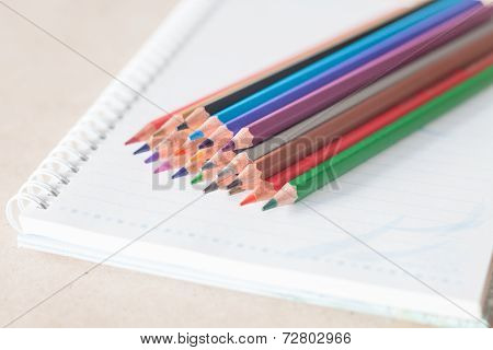 Closeup Colorful Pencil Crayons On Spiral Notebook