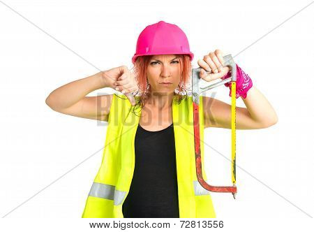 Worker Woman With Hacksaw Doing A Bad Signal