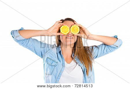 Girl Playing With Lemon Over White Background