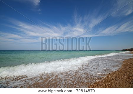 Oceanside Under Blue Sky With Clouds