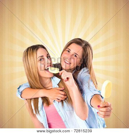 Friends Eating Ice Cream Over Ocher Background