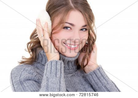 Happy Attractive Woman In Woolen Sweater And Muffs Isolated On White