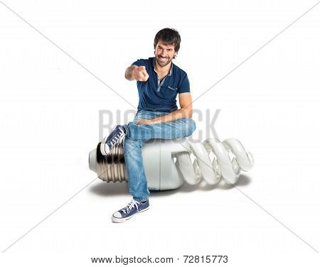 Man Pointing To The Front On Bulb