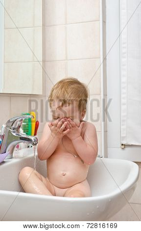 Little Girl Washing Face