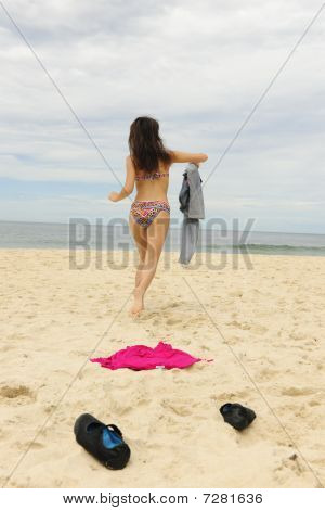 Woman Takes Off Her Colthes On The Beach