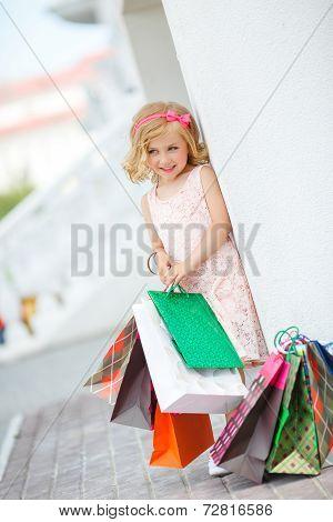 Blond girl doing shopping in shopping center