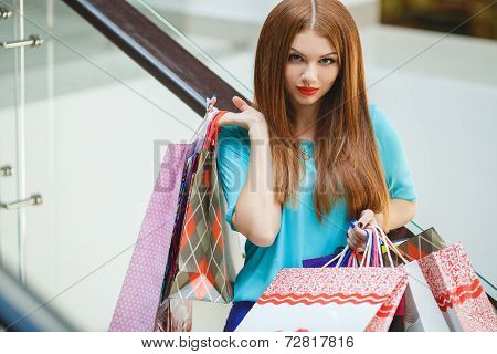 Attractive woman with shopping bags