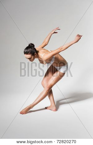 Ballerina Bending Down To Leg