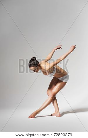 Ballerina Bending Down