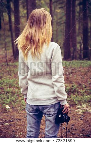 Young Woman walking with retro photo camera outdoor Lifestyle