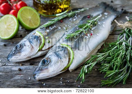 Two Raw Seabass With Lime, Cherry Tomatoes And Rosemary