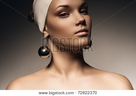 Beautiful Woman In Hat With Big Earrings