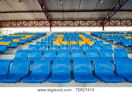 Empty Plastic Chairs  On Grandstand Stadium