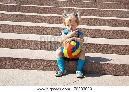 Adorable Little Child Girl With Toy Ball In Park.  Use It For Baby, Parenting Or Love Concept