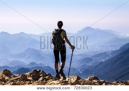 tourist woman on the top of mount