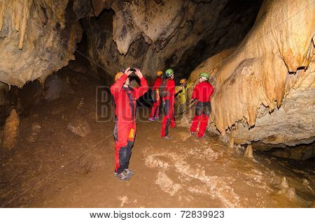 LLANES SPAIN - SEPTEMBER 4: A group of tourist in the cave