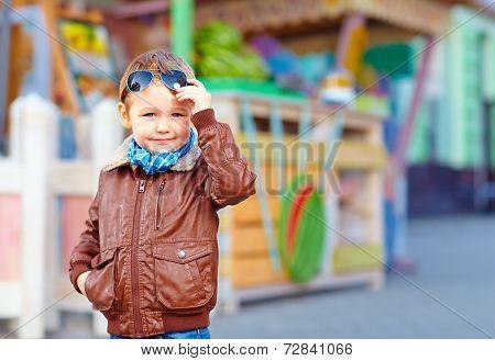 Stylish Boy Takes Off Sunglasses, On City Street