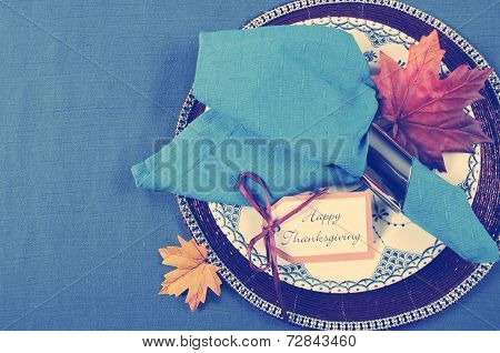 Vintage Style Happy Thanksgiving Dining Table Place Setting With Vintage Plate And Dark Blue Napkin