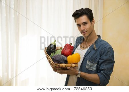 Young Man Holding A Basket Of Fresh Vegetables, Healthy Diet Concept