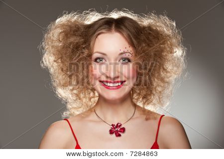 Smiley Young Woman With Hairdo