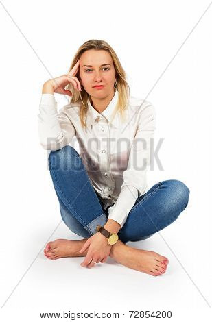 Portrait Of Attractive Young Blond Woman Sitting On Floor And Looking At Camera