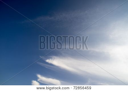 blue sky with white coud trails