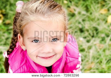 Autumn Portrait Of Cute Smiling Little Girl