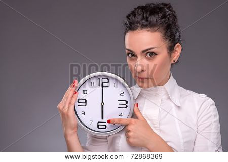 Portrait of nice girl holding big clock
