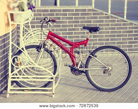 Lonely Bicycle On A Parking