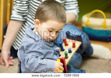 Little Child Boy Playing In Kindergarten In Montessori Preschool Class.