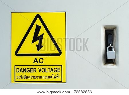 Warning Signpost High Voltage To Danger It Protection By Lock