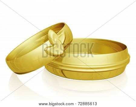 Pair Of Gold Wedding Rings With Hearts Design