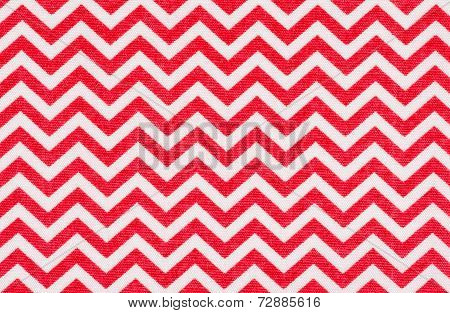 White fabric with a red chevron pattern