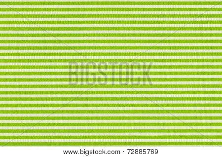 Macro shot of a White fabric with green stripes